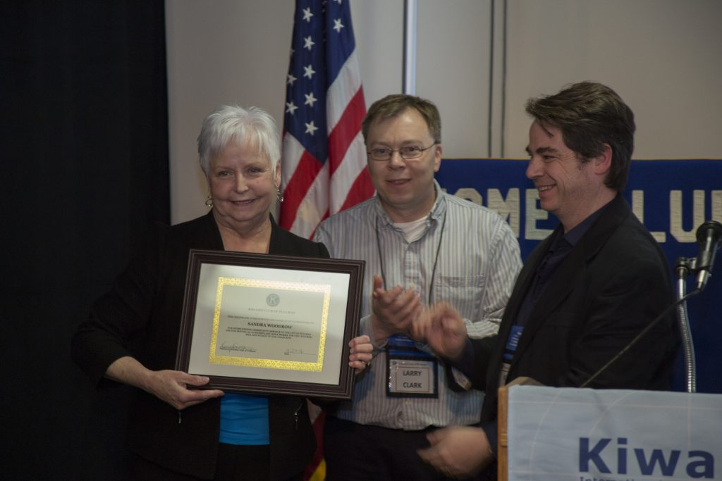 Sandra Woodrow (right) receives the 2016 Community Service Recognition award from Larry Clark and Pullman Kiwanis president Kerry Swanson.
