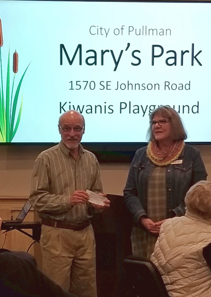Alan Davis from Pullman Parks and Rec with Pullman Kiwanis President Ginger Flynn as the Kiwanis Club gives $25,000 for Mary's Park